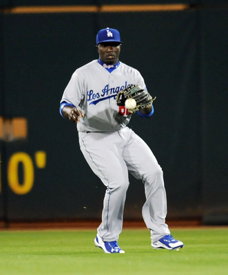 GOODYEAR, AZ - MARCH 03:  Trayvon Robinson #62 of the Los Angeles Dodgers fields a base hit against the Cincinnati Reds at Goodyear Ballpark on March 3, 2011 in Goodyear, Arizona.  (Photo by Norm Hall/Getty Images)