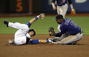 Johnny Herrera Lays Down the Tag on Angel Pagan Following a Perfect Throw From Carlos Gonzalez