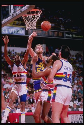 1989-1990:  Center Mark Eaton of the Utah Jazz (center) in action during a game against the Denver Nuggets at McNichols Arena in Denver, Colorado. Mandatory Credit: Tim de Frisco  /Allsport