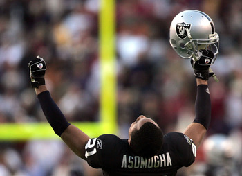 WASHINGTON - NOVEMBER 20:  Oakland Raiders cornerback Nnamdi Asomugha #21 celebrates after the Raiders recovered a game winning fumble in the fourth quarter on November 20, 2005 at Fed Ex Field in Landover, Maryland.  (Photo by Win McNamee/Getty Images)