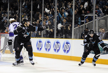 SAN JOSE, CA - APRIL 14: Logan Couture #39 and Dany Heatley #15 of the San Jose Sharks celebrates after Couture scores a goal against the Los Angeles Kings in Game One of the Western Conference Quarterfinals  during the 2011 NHL Stanley Cup Playoffs at th