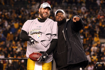 PITTSBURGH, PA - JANUARY 23:  Ben Roethlisberger #7 and head coach Mike Tomlin of the Pittsburgh Steelers celebrate their 24 to 19 win over the New York Jets in the 2011 AFC Championship game at Heinz Field on January 23, 2011 in Pittsburgh, Pennsylvania.
