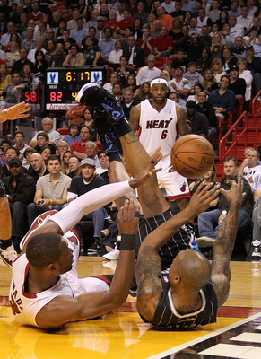 MIAMI, FL - MARCH 03:  Quentin Richardson #5 of the Orlando Magic tangles with Dwyane Wade #3 of the Miami Heat during a game at American Airlines Arena on March 3, 2011 in Miami, Florida. NOTE TO USER: User expressly acknowledges and agrees that, by down