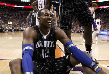 PHOENIX, AZ - MARCH 13:  Dwight Howard #12 of the Orlando Magic reacts to a foul call during the NBA game against the Phoenix Suns at US Airways Center on March 13, 2011 in Phoenix, Arizona. The Magic defeated the Suns 111-88. NOTE TO USER: User expressly