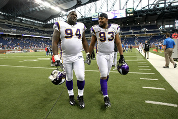 DETROIT - SEPTEMBER 20: Defensive linemen Pat Williams #94 and Kevin Williams #93 of the Minnesota Vikings walk off the field after the game with the Detroit Lions at Ford Field on September 20, 2009 in Detroit, Michigan. The Vikings won 27-13.  (Photo by