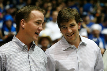 DURHAM, NC - MARCH 08:  Peyton Manning (L) and brother Eli Manning (R) watch on at the Duke Blue Devils versus North Carolina Tar Heels during their game at Cameron Indoor Stadium on March 8, 2008 in Durham, North Carolina.  (Photo by Streeter Lecka/Getty