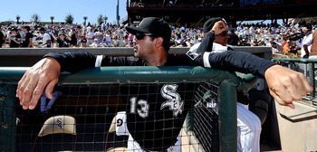 GLENDALE, AZ - MARCH 11:  Manager Ozzie Guillen #13 of the Chicago White Sox watches play in the spring training baseball game against Chicago Cubs at Camelback Ranch on March 11, 2011 in Glendale, Arizona.  (Photo by Kevork Djansezian/Getty Images)