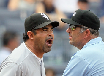 NEW YORK - MAY 02:  Manager Ozzie Guillen of the Chicago White Sox gets in a few last words with first base umpire Dale Scott after being ejected from the game against the New York Yankees by home plate umpire Dan Iassogna (not pictured) on May 2, 2010 at
