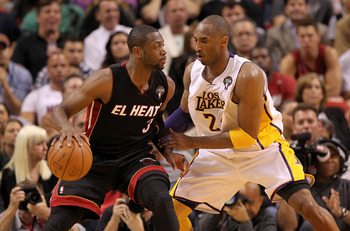 MIAMI, FL - MARCH 10:  Dwyane Wade #3 of the Miami Heat posts up Kobe Bryant #24 of the Los Angeles Lakers during a game at American Airlines Arena on March 10, 2011 in Miami, Florida. NOTE TO USER: User expressly acknowledges and agrees that, by download