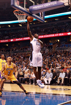 ORLANDO, FL - FEBRUARY 13:  Jason Richardson #23 of the Orlando Magic attempts a shot over Derek Fisher #2 of the Los Angeles Lakers during the game at Amway Arena on February 13, 2011 in Orlando, Florida.  NOTE TO USER: User expressly acknowledges and ag