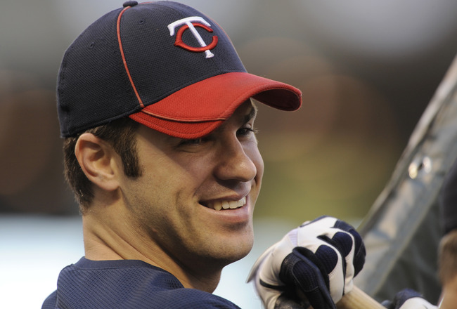 MINNEAPOLIS, MN - OCTOBER 6: Joe Mauer #7 of the Minnesota Twins looks on during batting practice prior to game one of the ALDS against the New York Yankees on October 6, 2010 at Target Field in Minneapolis, Minnesota. (Photo by Hannah Foslien/Getty Image