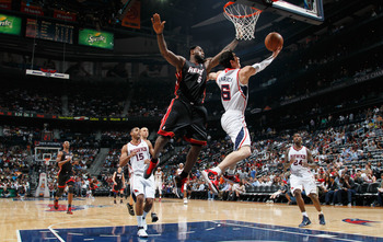 ATLANTA, GA - APRIL 11:  Kirk Hinrich #6 of the Atlanta Hawks lays in a basket against LeBron James #6 of the Miami Heat at Philips Arena on April 11, 2011 in Atlanta, Georgia.  NOTE TO USER: User expressly acknowledges and agrees that, by downloading and