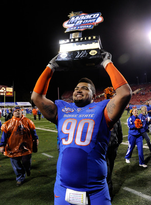 LAS VEGAS, NV - DECEMBER 22:  Billy Winn #90 of the Boise State Broncos holds up a trophy as he celebrates the team's 26-3 victory over the Utah Utes in the MAACO Bowl Las Vegas at Sam Boyd Stadium December 22, 2010 in Las Vegas, Nevada.  (Photo by Ethan