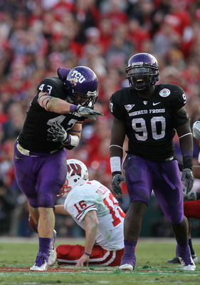 PASADENA, CA - JANUARY 01:  Linebacker Tank Carder #43 of the TCU Horned Frogs celebrates after a sack of quarterback Scott Tolzien #16 of the Wisconsin Badgers during the 97th Rose Bowl game on January 1, 2011 in Pasadena, California.  (Photo by Stephen