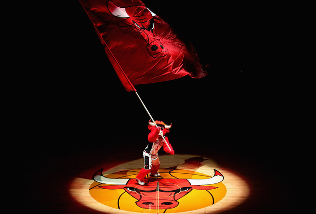 CHICAGO, IL - APRIL 13: Benny, the mascot of the Chicago Bulls, waves a flag before a game between the Bulls and the New Jersey Nets at the United Center on April 13, 2011 in Chicago, Illinois. The Bulls defeated the Nets 97-92. NOTE TO USER: User express