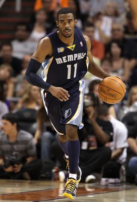 PHOENIX - NOVEMBER 05:  Mike Conley #11 of the Memphis Grizzlies handles the ball during the NBA game against the Phoenix Suns at US Airways Center on November 5, 2010 in Phoenix, Arizona. NOTE TO USER: User expressly acknowledges and agrees that, by down