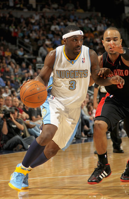 DENVER, CO - MARCH 21:  Ty Lawson #3 of the Denver Nuggets drives to the basket against Jerryd Bayless #5 of the Toronto Raptors at the Pepsi Center on March 21, 2011 in Denver, Colorado. The Nuggets defeated the Raptors 123-90. NOTE TO USER: User express