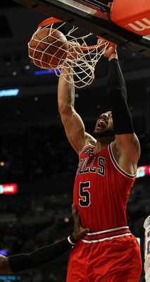 CHICAGO, IL - FEBRUARY 15: Carlos Boozer #5 of the Chicago Bulls dunks the ball against the Charlotte Bobcats at the United Center on February 15, 2011 in Chicago, Illinois. The Bulls defeated the Bobcats 106-94. NOTE TO USER: User expressly acknowledges