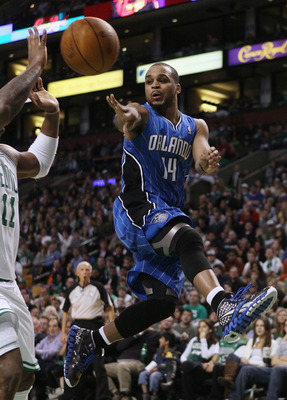 BOSTON, MA - FEBRUARY 06:  Jameer Nelson #14 of the Orlando Magic passes the ball around Glen Davis #11 of the Boston Celtics on February 6, 2011 at the TD Garden in Boston, Massachusetts. The Celtics defeated the Magic 91-80. NOTE TO USER: User expressly