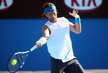 MELBOURNE, AUSTRALIA - JANUARY 19:  Carlos Moya of Spain plays a forehand in his first round match against Evgeny Korolev of Russia during day one of the 2009 Australian Open at Melbourne Park on January 19, 2009 in Melbourne, Australia.  (Photo by Mark K