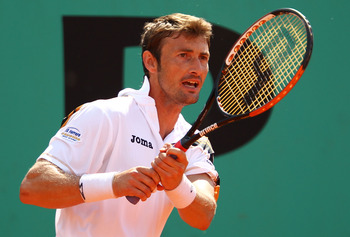PARIS - MAY 28:  Juan Carlos Ferrero of Spain plays a backhand during the men's singles second round match between Juan Carlos Ferrero of Spain and Pere Riba of Spain on day six of the French Open at Roland Garros on May 28, 2010 in Paris, France.  (Photo