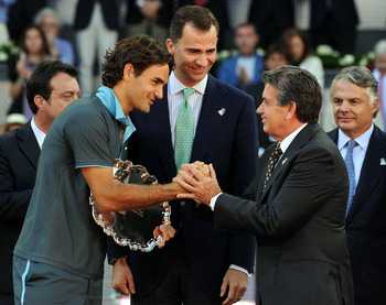 MADRID, SPAIN - MAY 17:  Roger Federer (L) of Switzerland is greeted by  former tennis great Manolo Santana (R) flanked by Crown Prince Felipe (C) of Spain after his straight set victory against Rafael Nadal of Spain during the final of the Madrid Open te