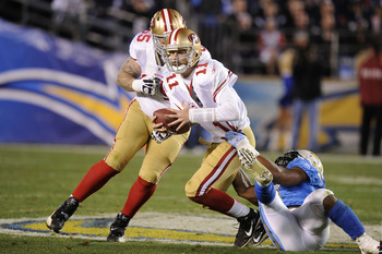 SAN DIEGO, CA - DECEMBER 16:  Quarterback Alex Smith #11 of the San Francisco 49ers is sacked by linebacker Antwan Barnes #98 of the San Diego Chargers in the fourth quarter at Qualcomm Stadium on December 16, 2010 in San Diego, California.  (Photo by Har