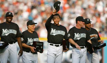 MIAMI - APRIL 10:  (L-R) Dontrelle Willis #35, Manager Jack McKeon #15, Miguel Cabrera #24, Jeff Conine #18 and Alex Gonzalez #11 of the Florida Marlins smile and acknowledge the fans after receiving their 2003 World Series Championship rings prior to the