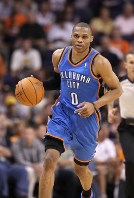 PHOENIX, AZ - MARCH 30:  Russell Westbrook #0 of the Oklahoma City Thunder handles the ball during the NBA game against the Phoenix Suns at US Airways Center on March 30, 2011 in Phoenix, Arizona. The Thunder defeated the Suns 116-98.   NOTE TO USER: User