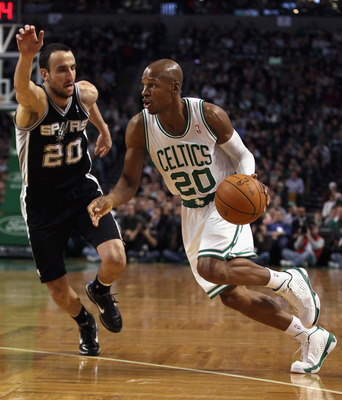 BOSTON, MA - JANUARY 05:  Ray Allen #20 of the Boston Celtics drives past Manu Ginobili #20 of the San Antonio Spurs on January 5, 2011 at the TD Garden in Boston, Massachusetts. NOTE TO USER: User expressly acknowledges and agrees that, by downloading an