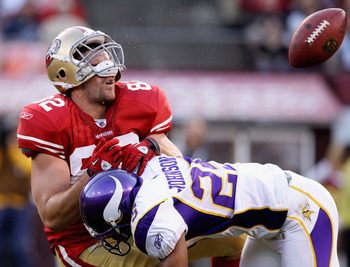 SAN FRANCISCO - AUGUST 22:  Nate Byham #82 of the San Francisco 49ers is hit by Tyrell Johnson #25 of the Minnesota Vikings during a preseason game at Candlestick Park on August 22, 2010 in San Francisco, California.  (Photo by Ezra Shaw/Getty Images)
