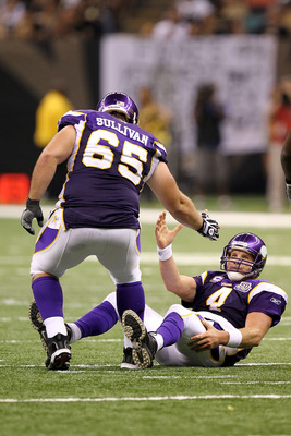 NEW ORLEANS - SEPTEMBER 09:  Quarterback Brett Favre #4 of  the Minnesota Vikings is helped up by teammate John Sullivan #65 against the New Orleans Saints at Louisiana Superdome on September 9, 2010 in New Orleans, Louisiana.  (Photo by Ronald Martinez/G