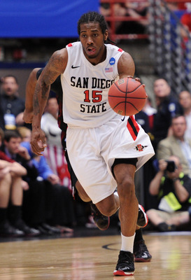TUCSON, AZ - MARCH 19:  Kawhi Leonard #15 of the San Diego State Aztecs drives against the Temple Owls during the third round of the 2011 NCAA men's basketball tournament at McKale Center on March 19, 2011 in Tucson, Arizona.  (Photo by Harry How/Getty Im