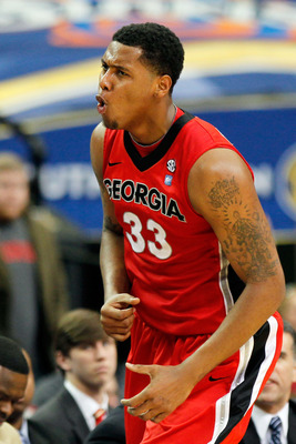 ATLANTA, GA - MARCH 11:  Trey Thompkins #33 of the Georgia Bulldogs celebrates after hitting a 3 point shot against the Alabama Crimson Tide during the quarterfinals of the SEC Men's Basketball Tournament at Georgia Dome on March 11, 2011 in Atlanta, Geor