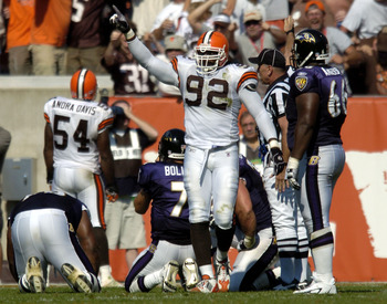 CLEVELAND, OH - SEPTEMBER 12:  Courtney Brown #92 of the Cleveland Browns celebrates a Baltimore turnover near the goal line that would set up a Cleveland score in the fourth quarter on September 12, 2004 at Cleveland Browns Stadium in Cleveland, Ohio.  C