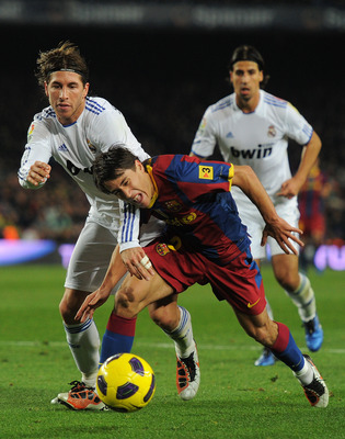 BARCELONA, SPAIN - NOVEMBER 29:  Bojan Krkic (R) of Barcelona fights for the ball with Sergio Ramos of Real Madrid during the la liga match between Barcelona and Real Madrid at the Camp Nou stadium on November 29, 2010 in Barcelona, Spain.  (Photo by Jasp