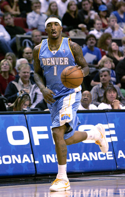 ORLANDO, FL - FEBRUARY 13:  J.R. Smith, #1 of the Denver Nuggets, sets up the offense in a game against the Orlando Magic at Amway Arena on February 13, 2008 in Orlando Florida. NOTE TO USER: User expressly acknowledges and agrees that, by downloading and