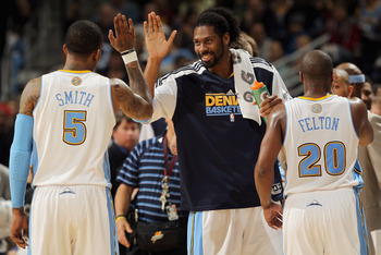 DENVER, CO - MARCH 12:  Nene #31 of the Denver Nuggets welcomes teammates J.R. Smith #5 and Raymond Felton #20 to the bench for a time out against the Detroit Pistons at the Pepsi Center on March 12, 2011 in Denver, Colorado. The Nuggets defeated the Pist