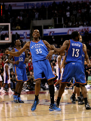 LOS ANGELES - NOVEMBER 11: Kevin Durant #35 of  the Oklahoma City Thunder celebrates with James Harden #13 after his basket gave the Thunder the lead for good with 38 seconds remaining in the game against the Los Angeles Clippers on November 11, 2009 at S