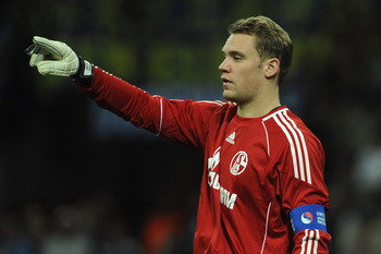 MILAN, ITALY - APRIL 05:  Goalkeeoer Manuel Neuer of Schalke 04 issues instructions during the UEFA Champions League Quarter Final match between FC Internazionale Milano and Schalke 04 at San Siro Stadium on April 5, 2011 in Milan, Italy.  (Photo by Valer