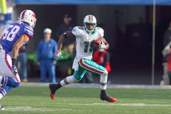 ORCHARD PARK, NY - NOVEMBER 29:  Ted Ginn Jr. #19 of the Miami Dolphins carries the ball during the game against the Buffalo Bills at Ralph Wilson Stadium on November 29, 2009 in Orchard Park, New York. Buffalo won 31-14. (Photo by Rick Stewart/Getty Imag