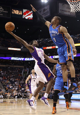 PHOENIX, AZ - MARCH 30:  Aaron Brooks #0 of the Phoenix Suns puts up a shot against Russell Westbrook #0 of the Oklahoma City Thunder during the NBA game at US Airways Center on March 30, 2011 in Phoenix, Arizona.  The Thunder defeated the Suns 116-98. NO