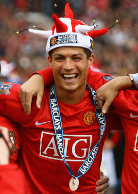 MANCHESTER, ENGLAND - MAY 16:  Cristiano Ronaldo of Manchester United celebrates winning the Barclays Premier League trophy after the Barclays Premier League match between Manchester United and Arsenal at Old Trafford on May 16, 2009 in Manchester, Englan