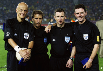 YOKOHAMA - JUNE 30:  Referee Pierluigi Collina, assistant referees Leif Lindberg and Phillip Sharp and fourth official Hugh Dallas before the Germany v Brazil, World Cup Final match played at the International Stadium Yokohama in Yokohama, Japan on June 3