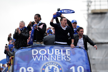 LONDON, ENGLAND - MAY 16:  Chelsea captain John Terry and Didier Drogba celebrate during the Chelsea FC Victory Parade on May 16, 2010 in London, England.  (Photo by Shaun Botterill/Getty Images)