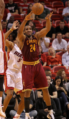 MIAMI, FL - JANUARY 31: Samardo Samuels #24 of the  Cleveland Cavaliers  passes out of trouble during a game against the Miami Heat  at American Airlines Arena on January 31, 2011 in Miami, Florida. NOTE TO USER: User expressly acknowledges and agrees tha