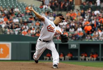 BALTIMORE, MD - APRIL 10:  Starting pitcher Jeremy Guthrie #46 of the Baltimore Orioles delivers to a Texas Rangers batter during the third inning at Oriole Park at Camden Yards on April 10, 2011 in Baltimore, Maryland.  (Photo by Rob Carr/Getty Images)