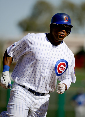 MESA, AZ - MARCH 09:  Marlon Byrd #24 of the Chicago Cubs runs the bases against the Kansas City Royals during the spring training baseball game at HoHoKam Stadium on March 9, 2011 in Mesa, Arizona.  (Photo by Kevork Djansezian/Getty Images)