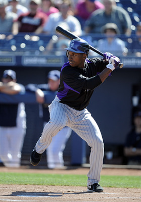 PEORIA, AZ - MARCH 02:  Jonathan Herrera #18 of the Colorado Rockies at bat against the San Diego Padres during spring training at Peoria Stadium on March 2, 2011 in Peoria, Arizona.  (Photo by Harry How/Getty Images)