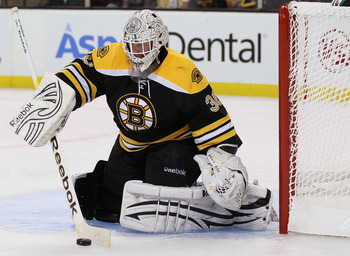 BOSTON, MA - APRIL 14:  Tim Thomas #30 of the Boston Bruins stops a shot in the second period against the Montreal Canadiens in Game One of the Eastern Conference Quarterfinals during the 2011 NHL Stanley Cup Playoffs at TD Garden on April 14, 2011 in Bos
